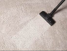 vacuuming a rug, before and after difference